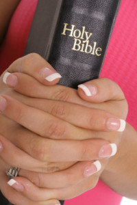 female hands holding bible